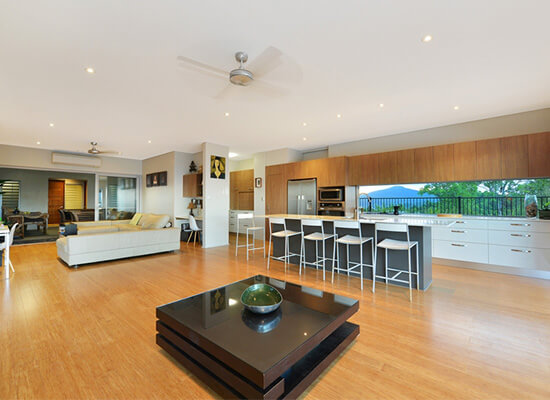 Open plan living & kitchen area in custom designed home by Cairns Builder, Maxa Constructions.