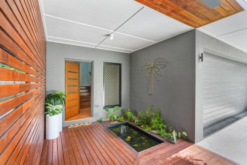 Timber deck and screen entrance to modern tropical home.