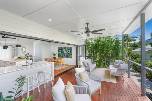 Tropical home deck, kitchen and dining area.