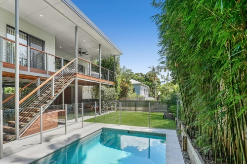 Exterior pool and deck of new custom designed home in Cairns.